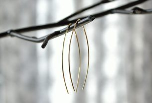 Simple sterling silver wishbone earring